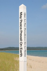 Four sided white pole, 4 languages
